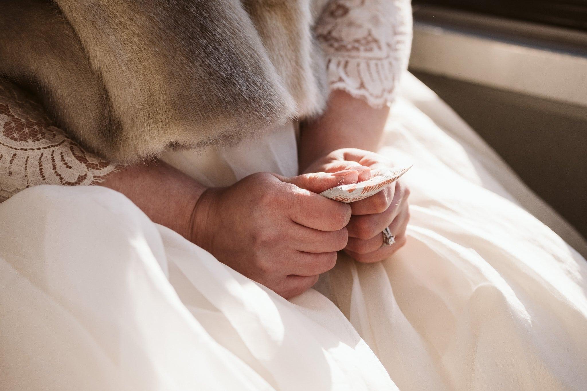 Bride holding handwarmers