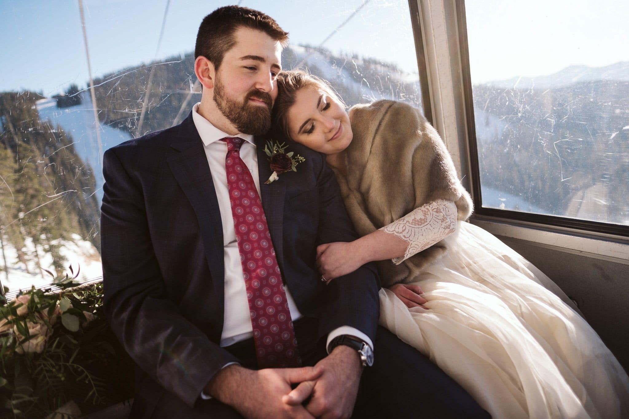 Bride and groom ride gondola at Keystone Ski Resort in Colorado for their winter wedding.