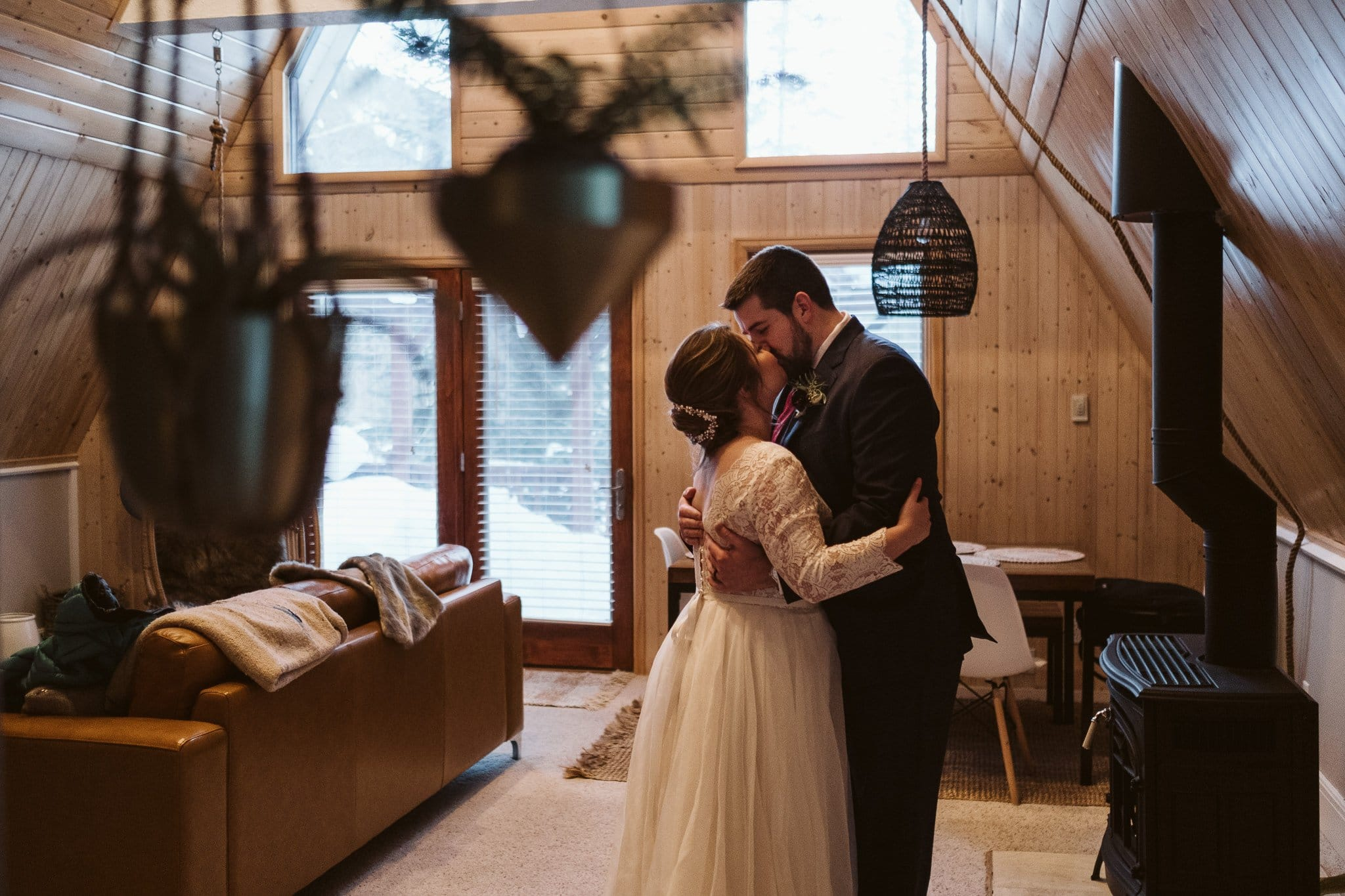 First dance in front of the fireplace at A-frame cabin in Colorado.