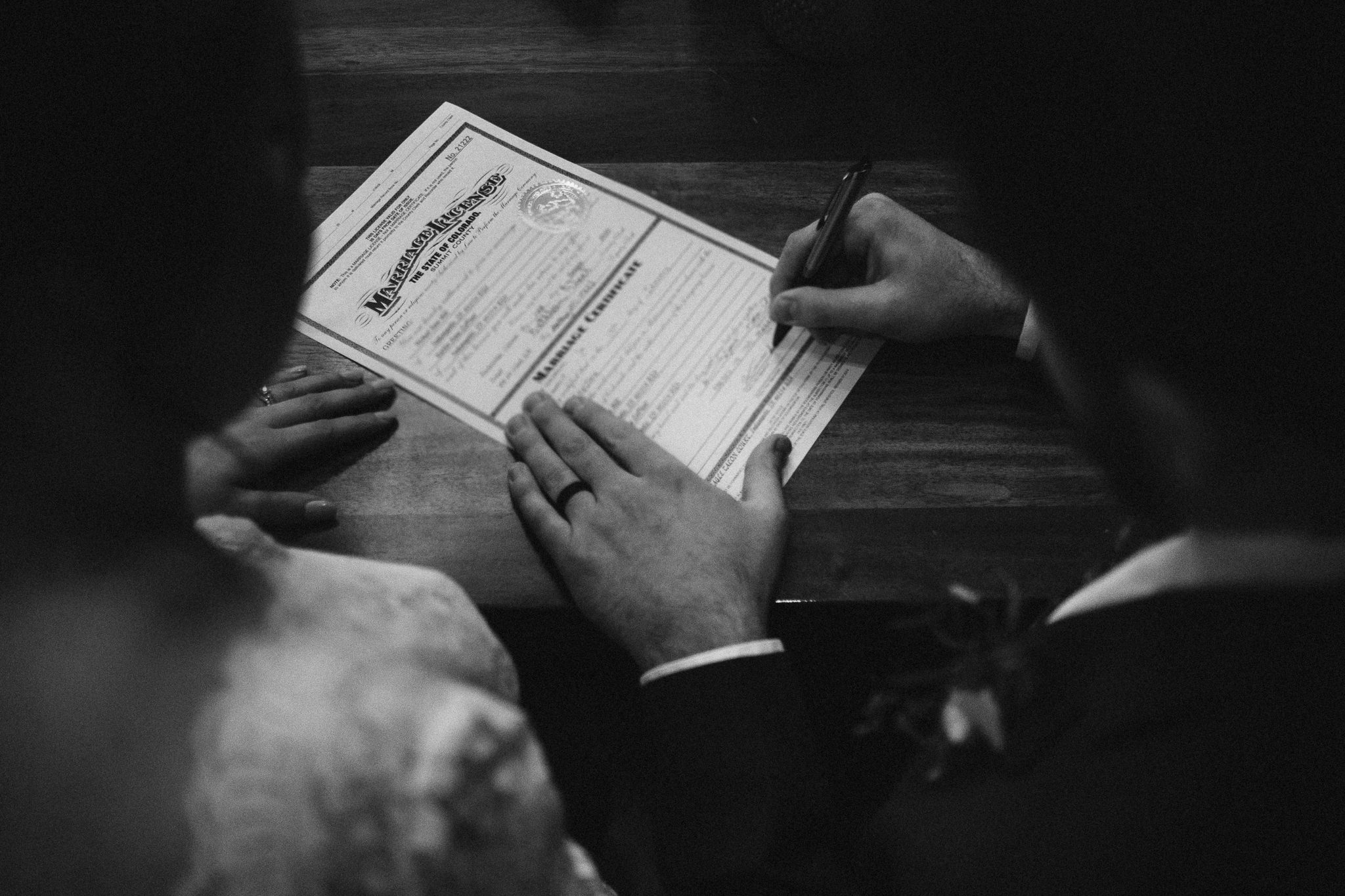 Bride and groom self-solemnize their marriage license at Breckenridge elopement.