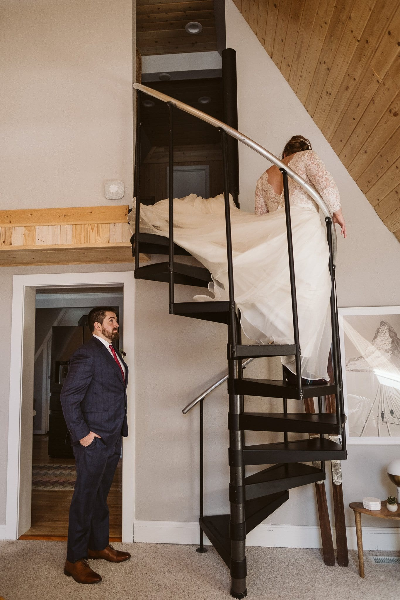 Bride and groom first look walking down stairs, A-frame cabin elopement in Breckenridge, Colorado.