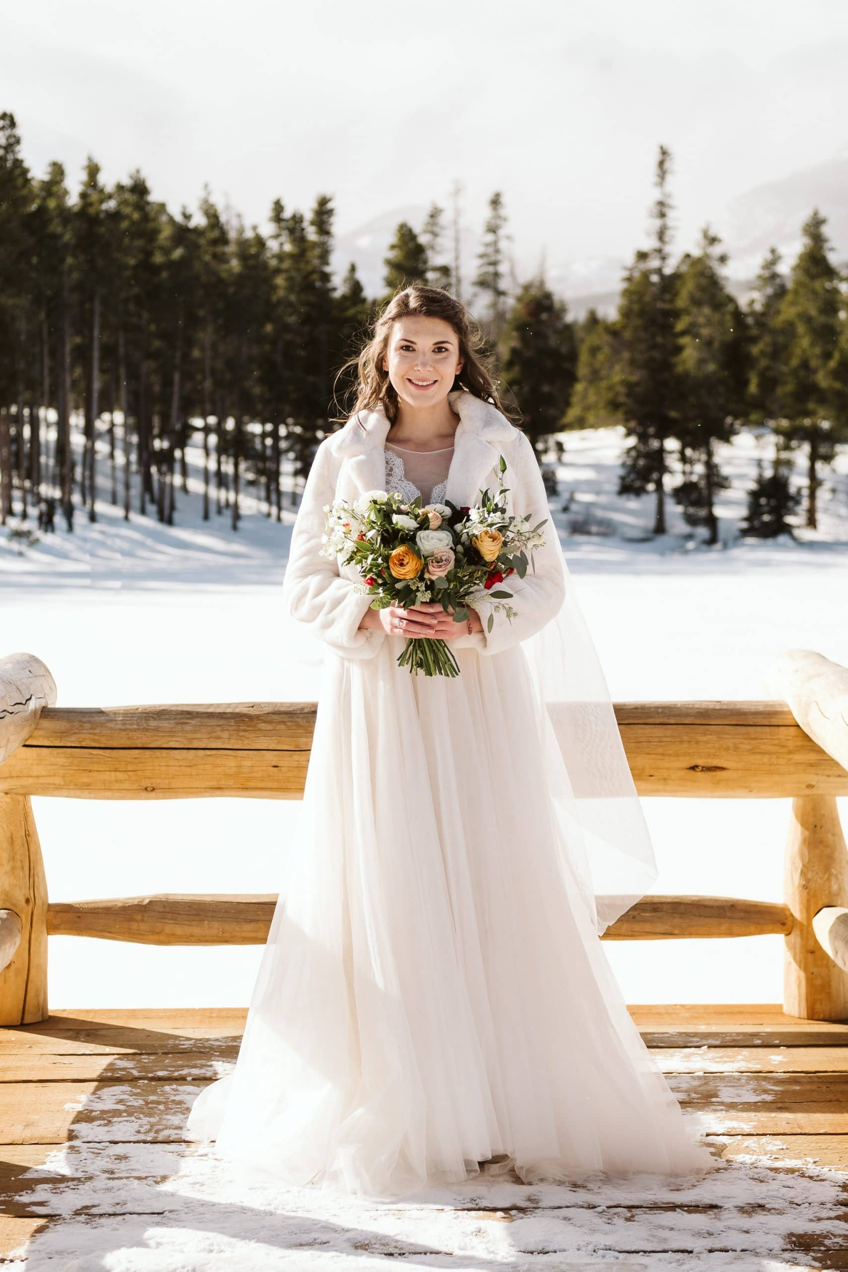 Bridal portrait at Sprague Lake elopement in Rocky Mountain National Park in winter.