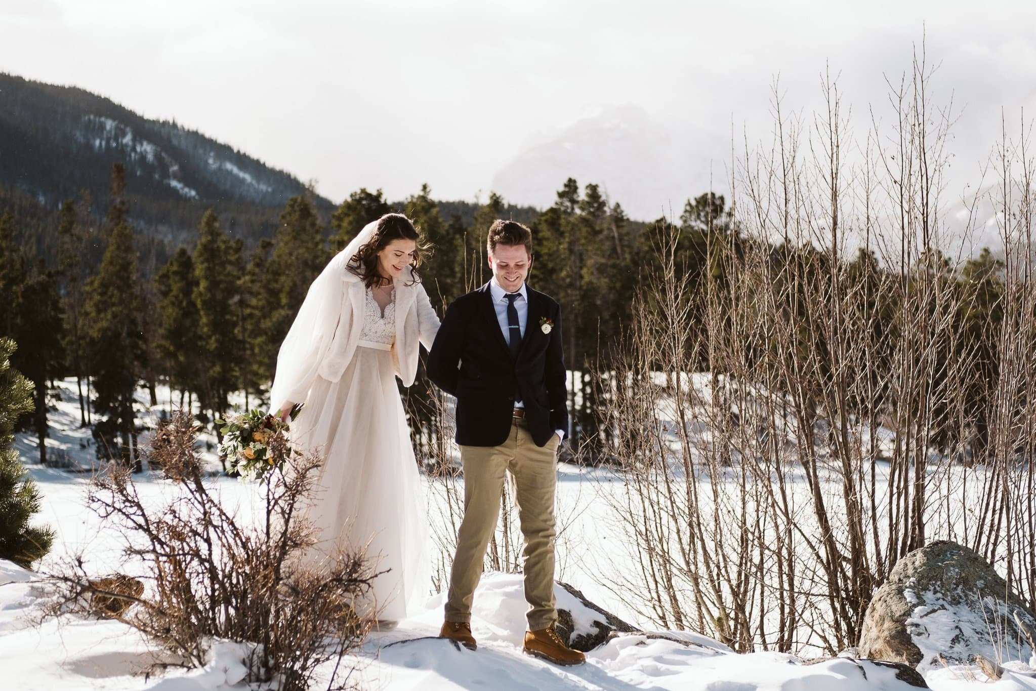 Bride and groom hiking in Rocky Mountain National Park at their elopement.