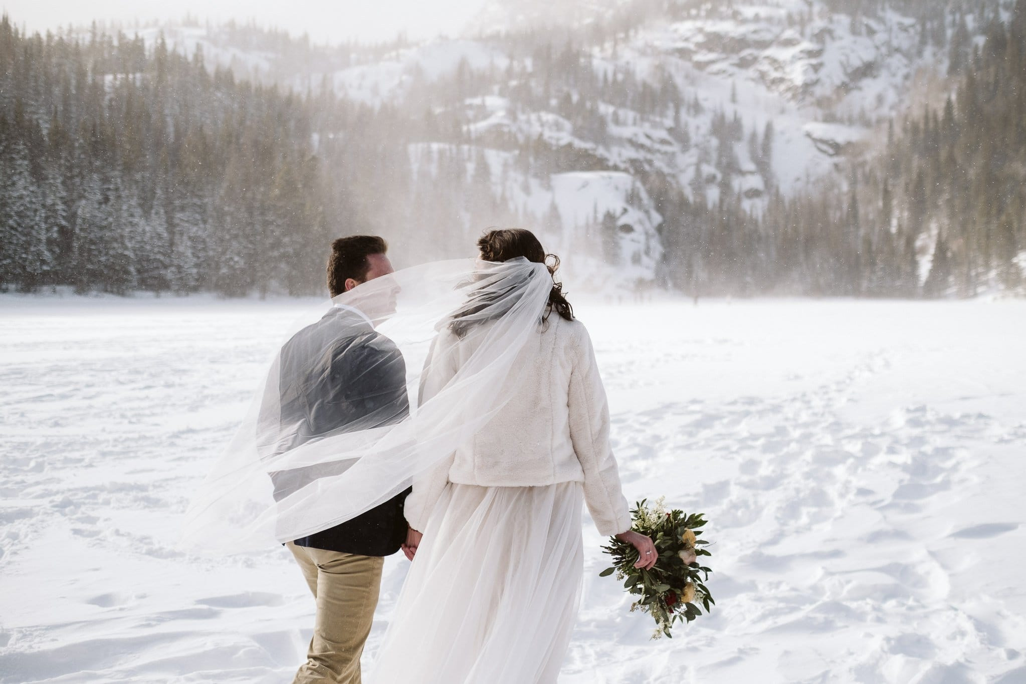 Winter elopement at Bear Lake in Rocky Mountain National Park.