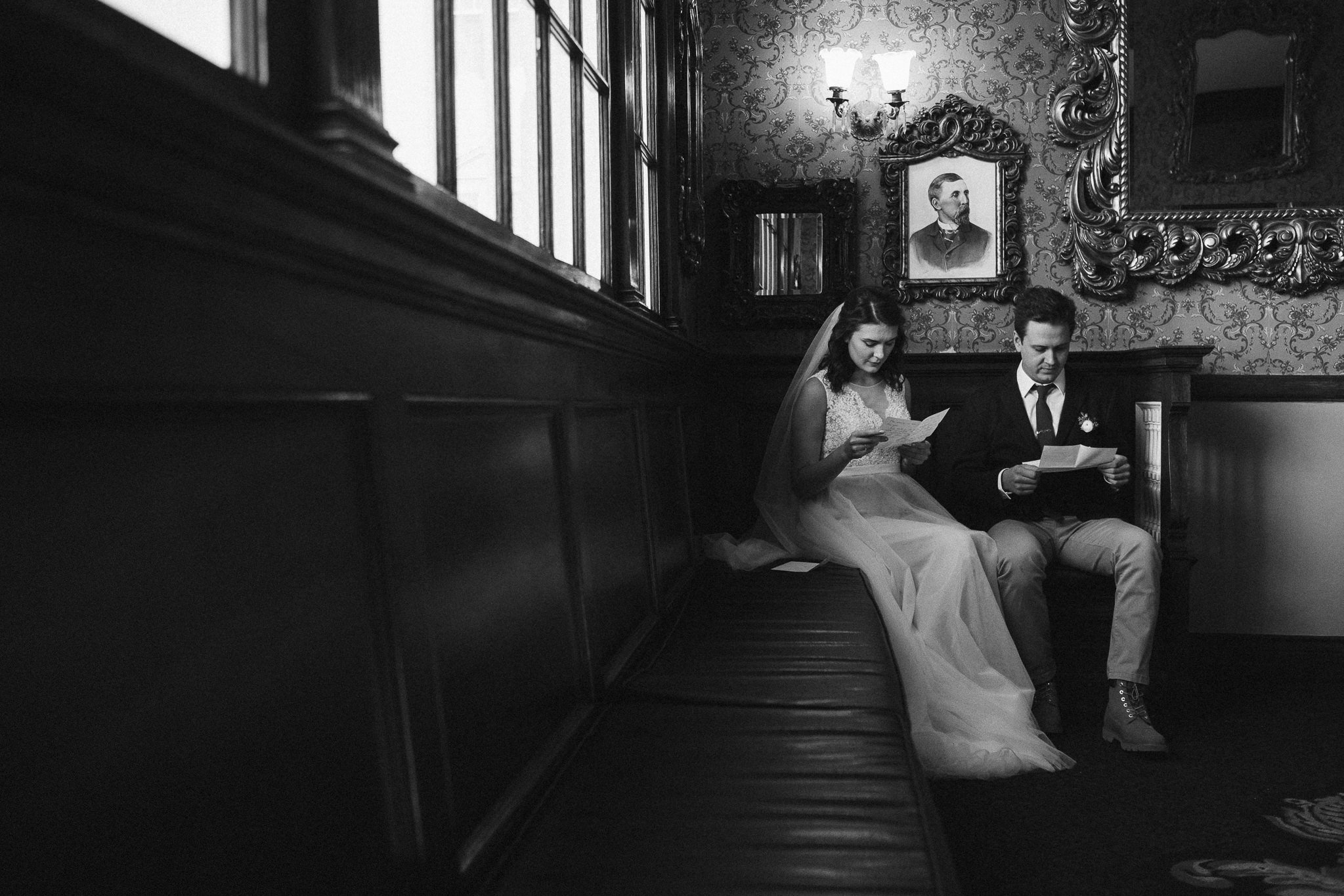 Bride and groom read private letters to each other at the Stanley Hotel in Estes Park.