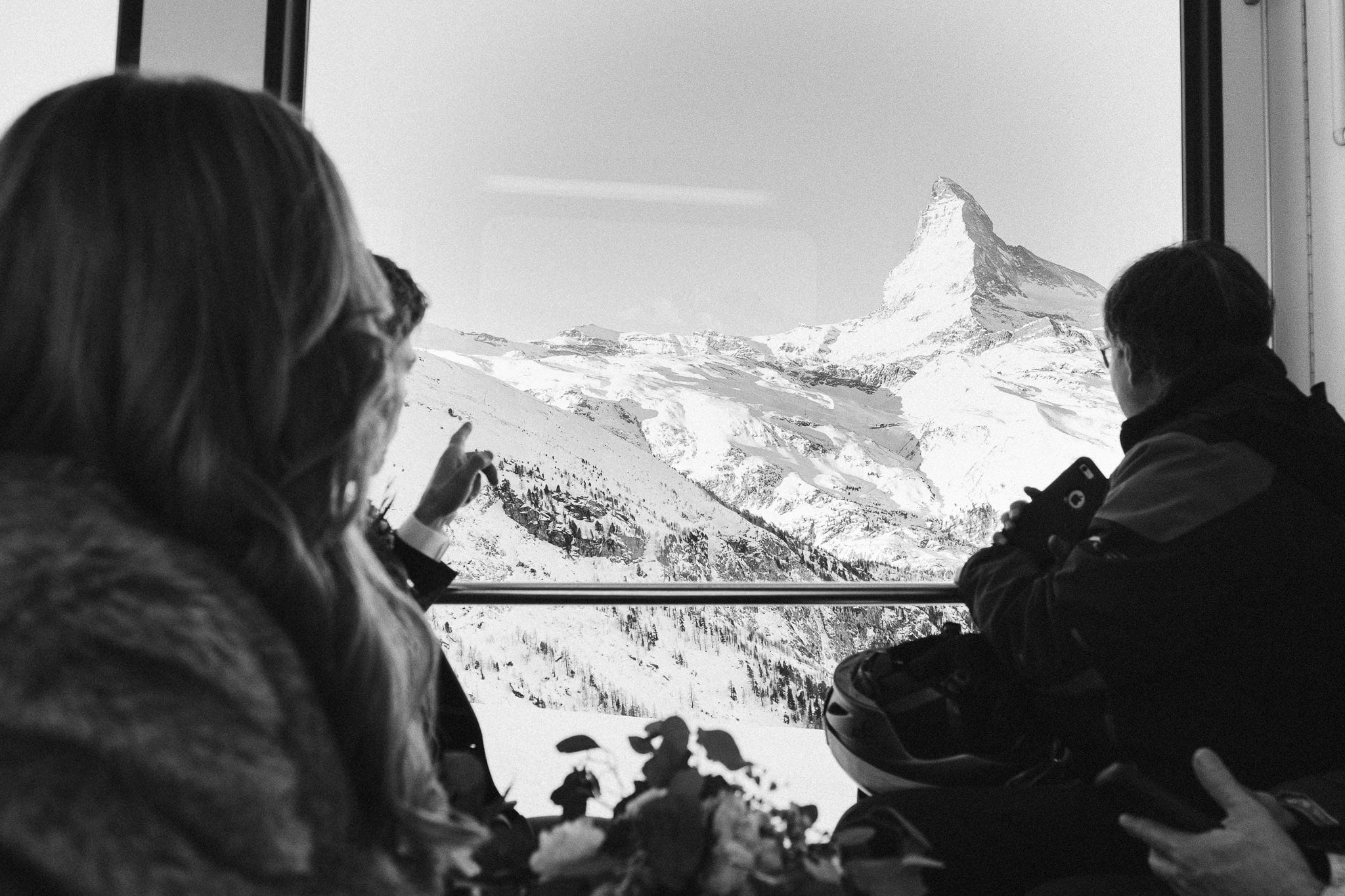 Bride and groom ride the ski train Gornergratbahn in Zermatt, Switzerland.