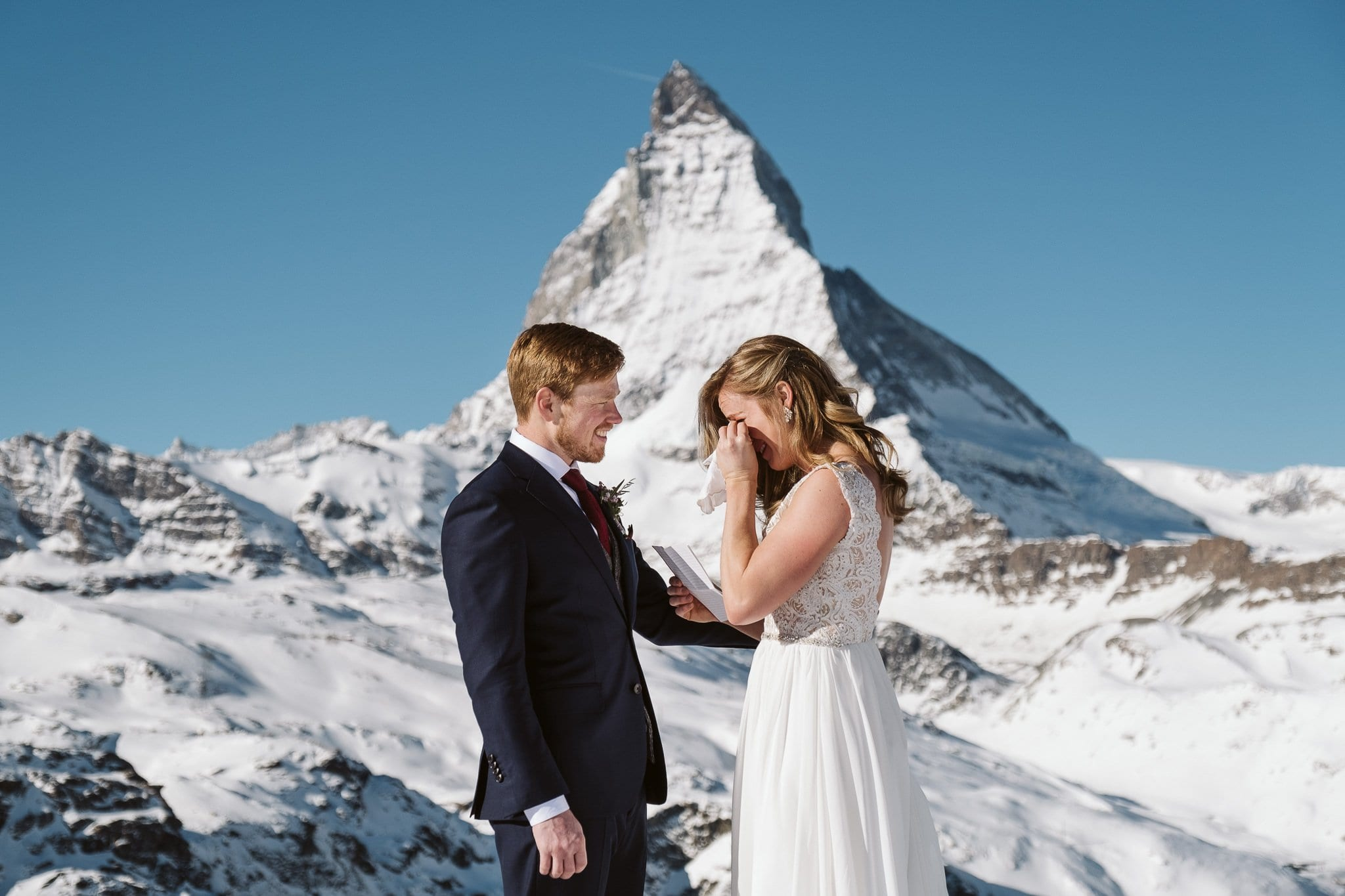 Bride and groom exchange wedding vows in front of Matterhorn in Zermatt. Switzerland elopement photographer.