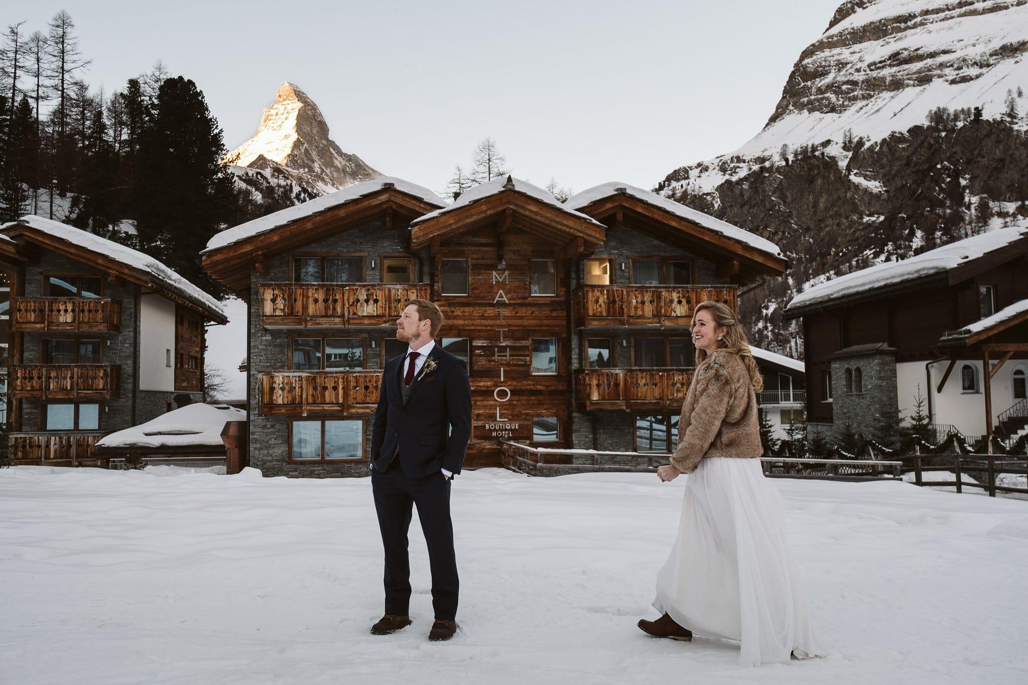 Bride and groom first look outside of Matthiol Boutique Hotel in Zermatt. Switzerland adventure elopement at Matterhorn.