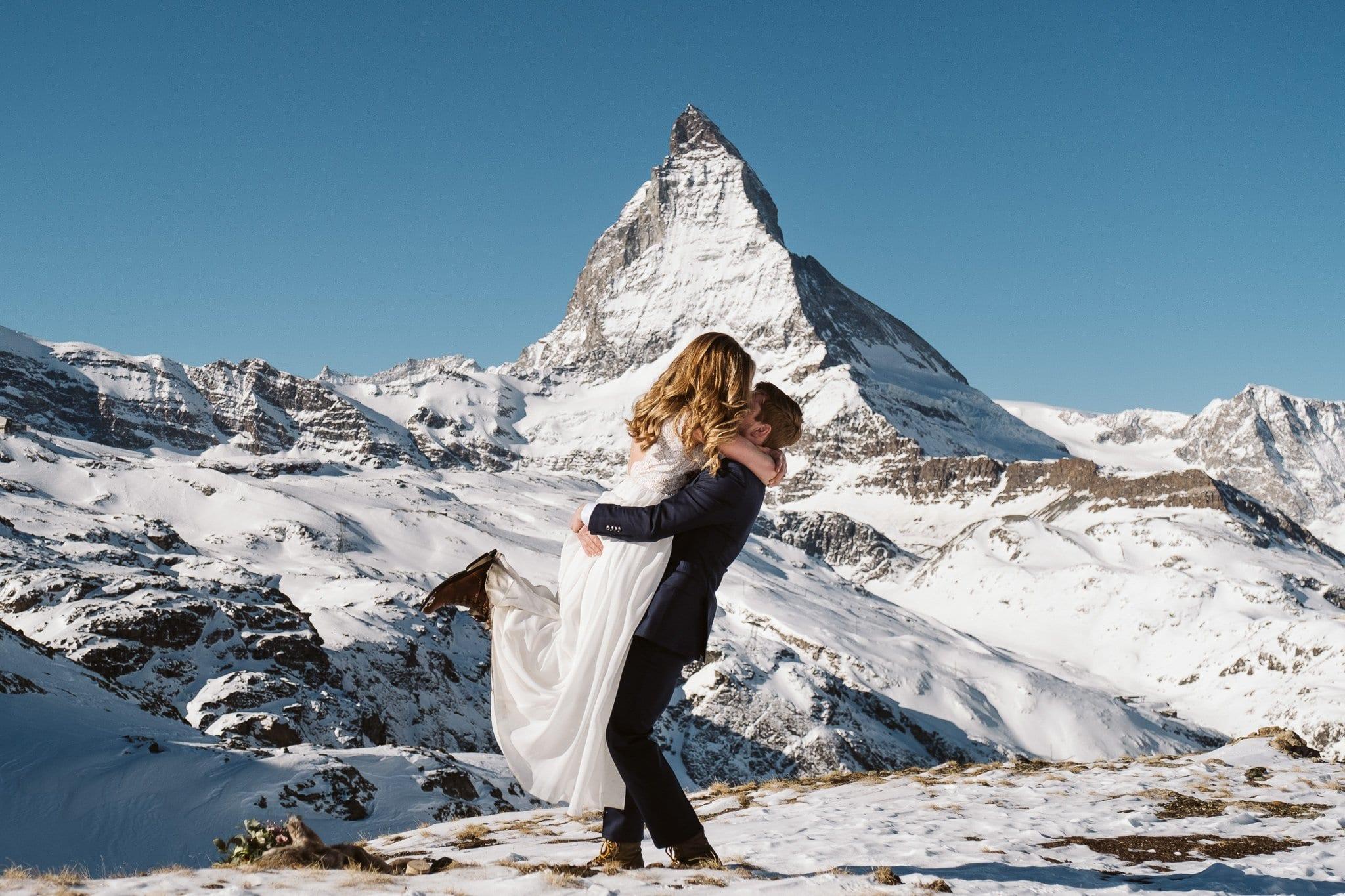 Bride and groom in front of Matterhorn in Zermatt. Switzerland elopement photographer.