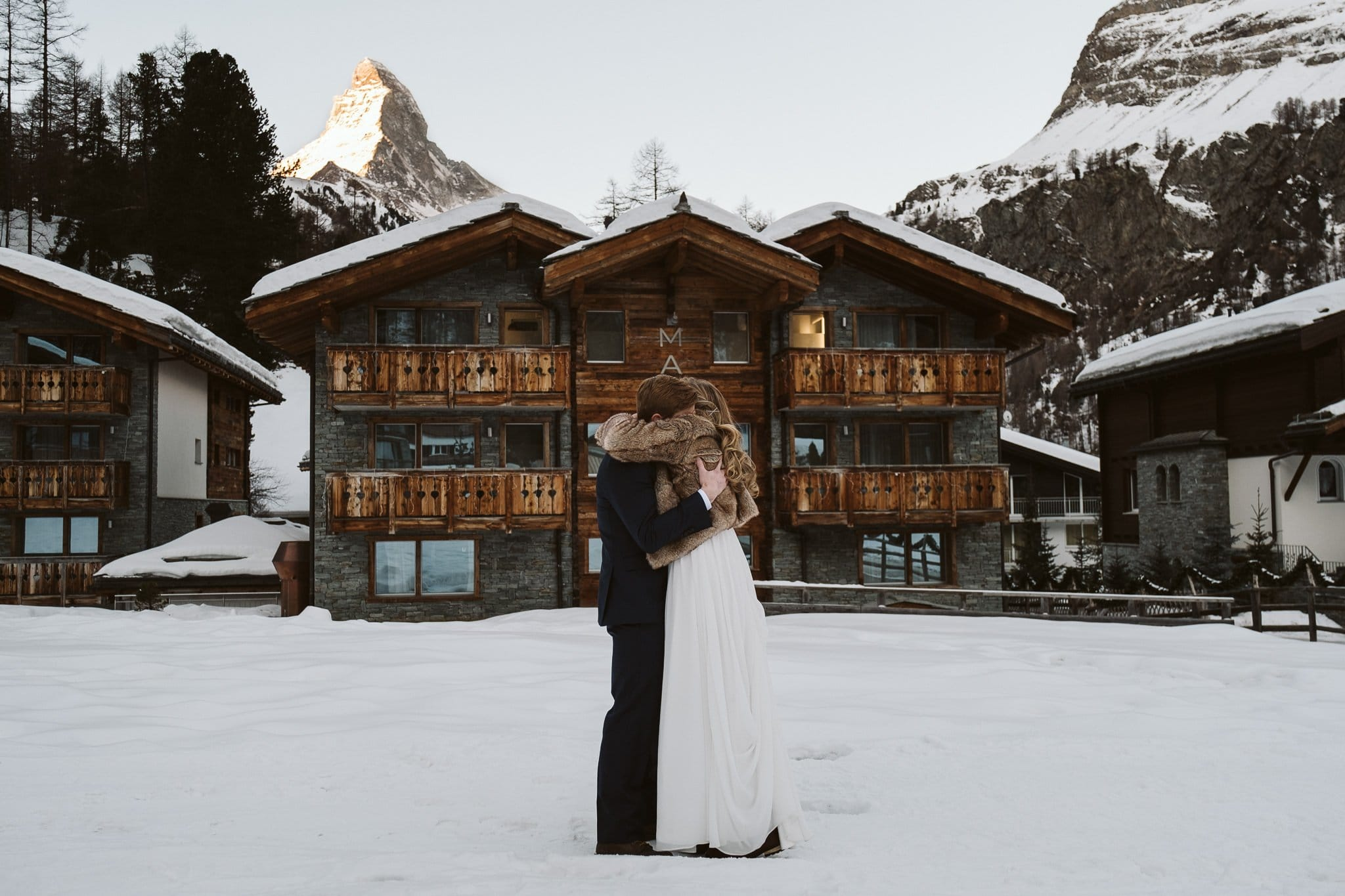 Bride and groom first look outside of Matthiol Boutique Hotel in Zermatt. Switzerland adventure elopement at Matterhorn.