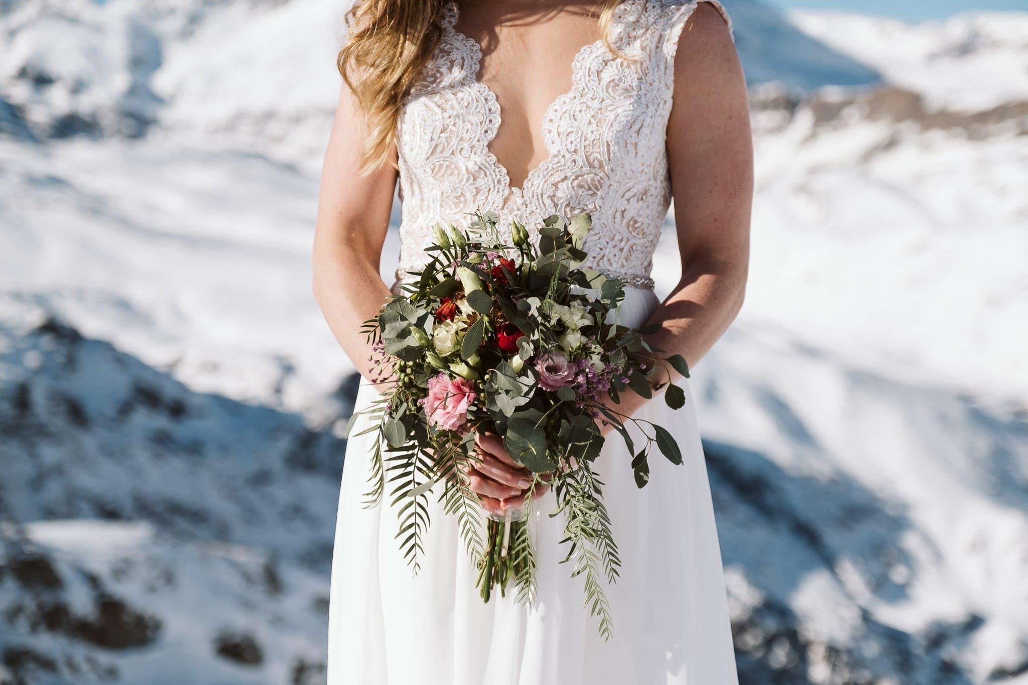 Bride portrait with wedding bouquet in front of Matterhorn in Zermatt, Switzerland wedding photographer.