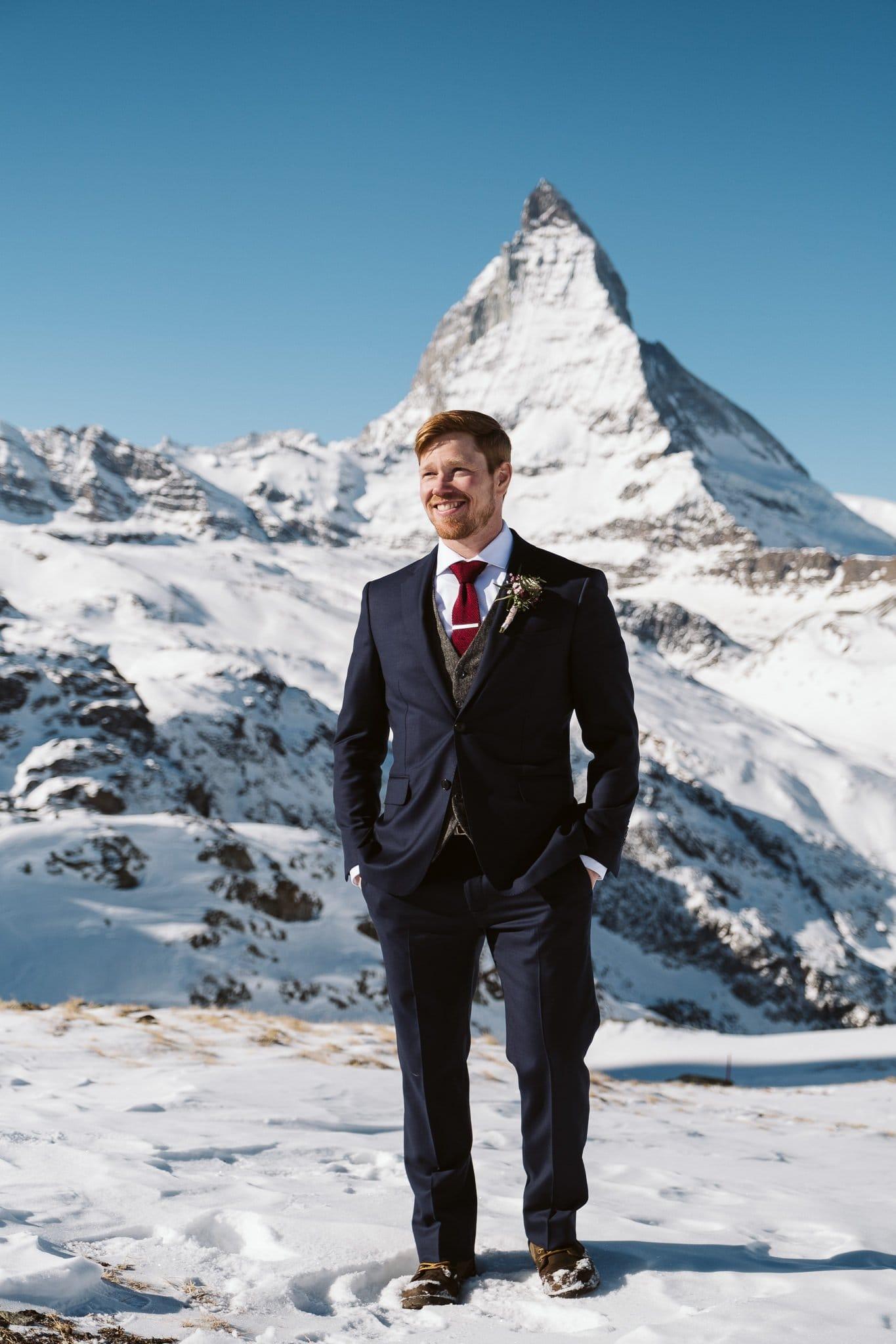 Groom wearing three-piece tweed suit in front of Matterhorn in Zermatt, Switzerland wedding photographer.
