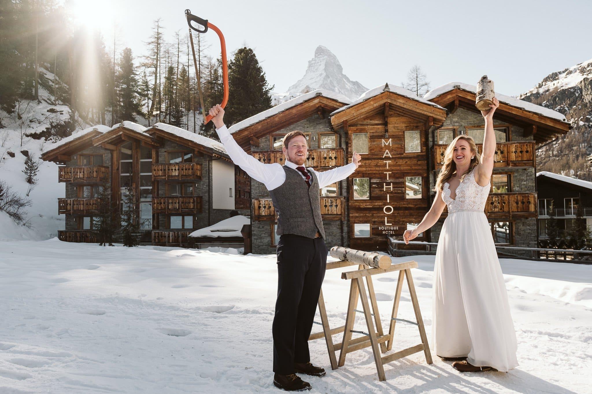 Bride and groom baumstamm sagen in front of Matthiol Boutique Hotel in Zermatt, Switzerland.