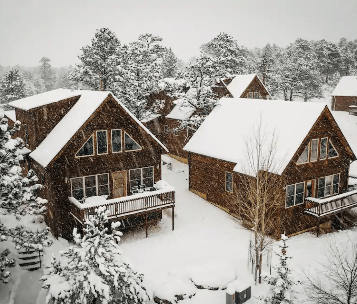 Snow-covered cabin in Estes Park