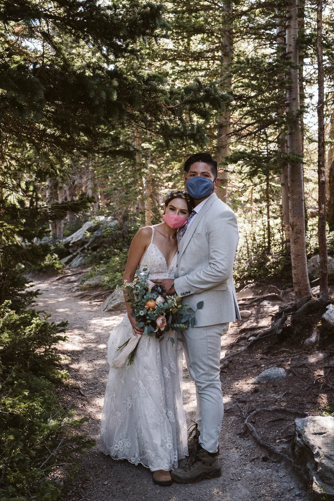 Bride and groom wear masks