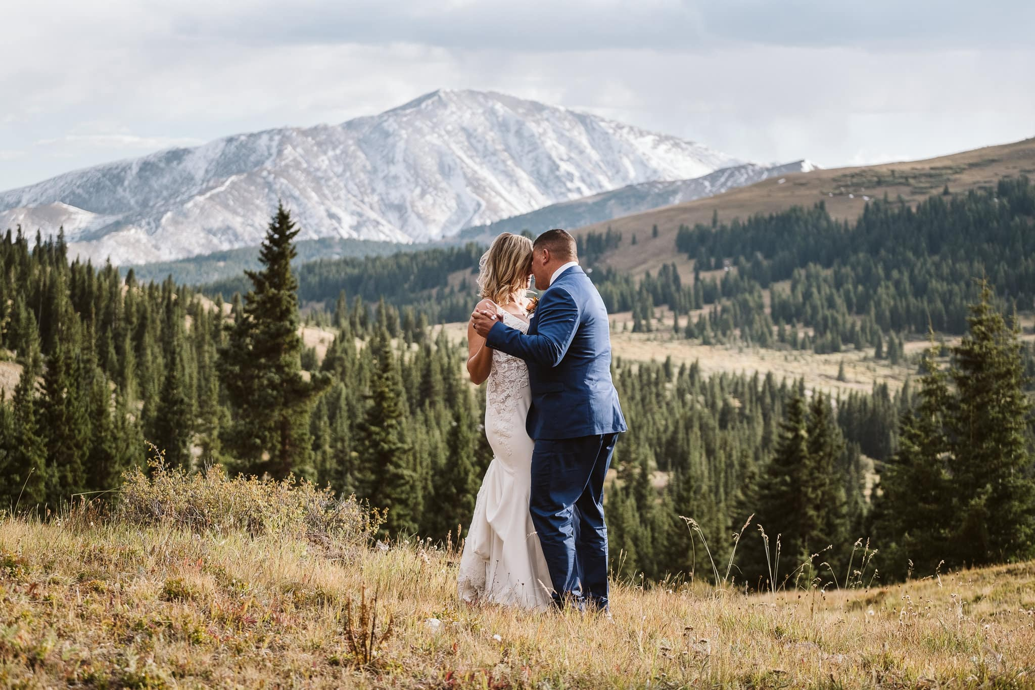 Bride and groom share first dance in the mountains