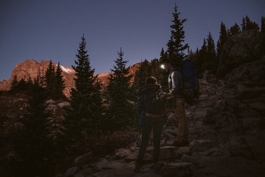 Couple hiking by headlamps