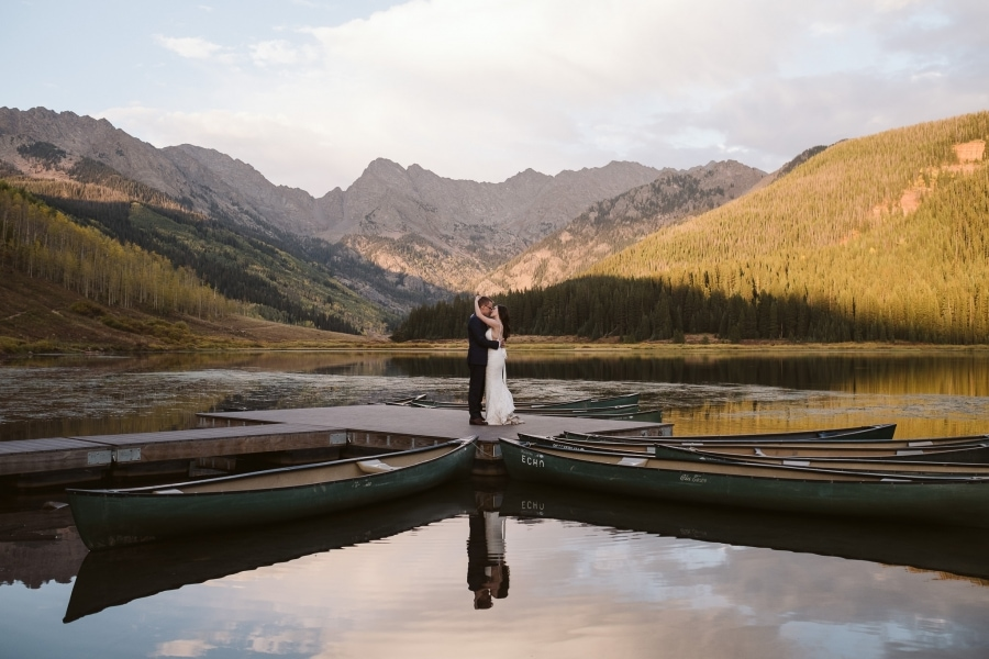 Bride and groom on a canoe dock at Piney River Ranch in Colorado