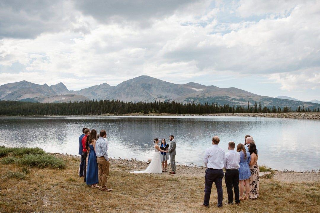 Intimate wedding at alpine lake near Boulder, Colorado.