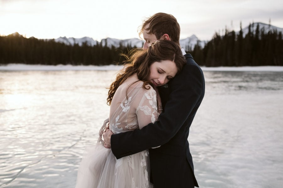 Winter elopement on frozen alpine lake near Boulder, Colorado